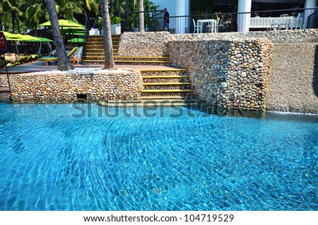 Beautiful and refreshing landscaped rock pool view - stock photo