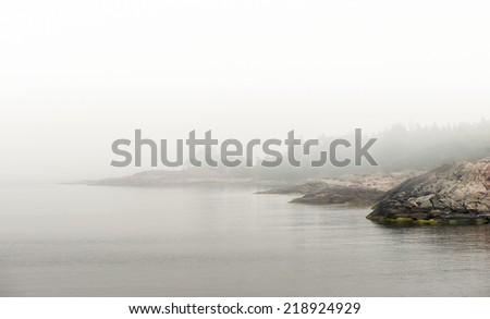Beautiful and Rugged Coastal region in morning during fog. Grisslehamn, Sweden  - stock photo
