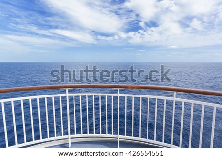Beautiful and scenic view from a cruise ship deck of the gorgeous deep blue ocean and blue sky