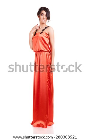 Beautiful and sensual woman in cocktail evening dress isolated over white background. Studio shooting. Sensuality and sexuality. Beauty and fashion - stock photo