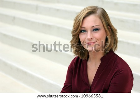 Beautiful and Serious Business Woman Smiling, and Looking At Camera - stock photo