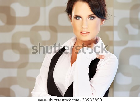 Beautiful and sexy brunette business woman on brown background.