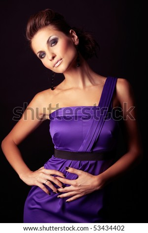 beautiful and sexy brunette fashion girl in violet dress - portrait