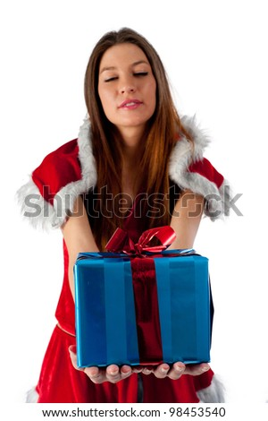 Beautiful and sexy christmas woman with gift - stock photo