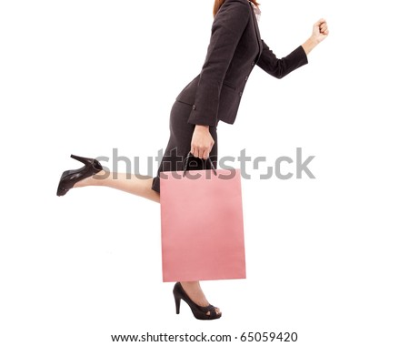 Beautiful and sexy shopping woman with pink shopping bag - stock photo