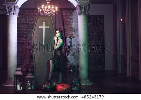 Beautiful and sexy vampire in her mansion. Halloween