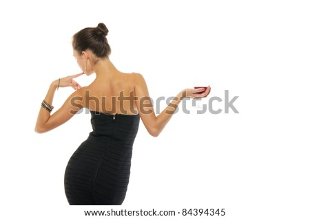 Beautiful and sexy woman in dress with glass of wine isolated on white - stock photo