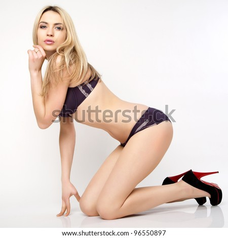 Beautiful and sexy woman wearing lingerie. - stock photo