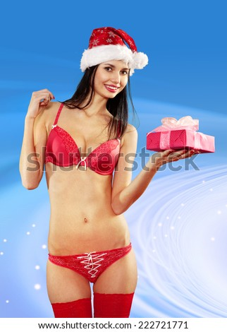 Beautiful and sexy woman with gift wearing santa clause costume  - stock photo
