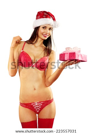 Beautiful and sexy woman with gift wearing santa clause costume on white background - stock photo