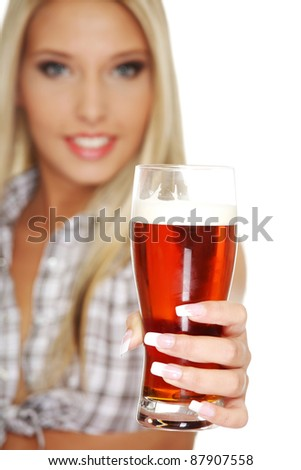 Beautiful and sexy young blond smiling woman giving beer, isolated on white - stock photo