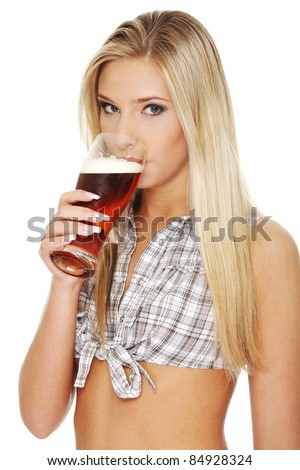 Beautiful and sexy young blond  woman drinking beer, isolated on white - stock photo