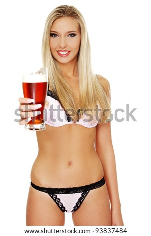 Beautiful and sexy young blond woman holding glass of beer, isolated on white - stock photo