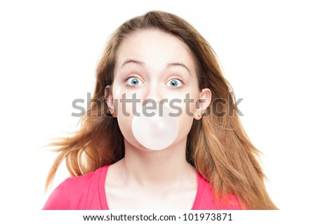 Beautiful and shocked or surprised young student girl blowing bubble from chewing gum. Looking into the camera. Isolated on white background. - stock photo