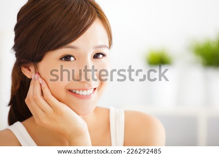 beautiful and smiling asian young woman - stock photo