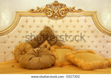 Beautiful and soft pillows on a smart bed - stock photo