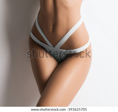 Beautiful and sporty belly over white background - stock photo