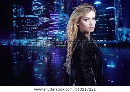 Beautiful and stylish young blonde girl, on the background of night city - stock photo