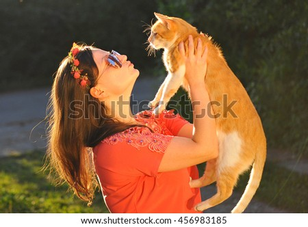 Beautiful and tender moment between cute woman and her cat