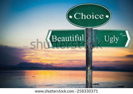 Beautiful and Ugly directions. Opposite traffic sign. - stock photo