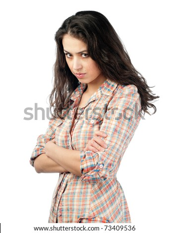 beautiful and unhappy young woman with dark wavy hair looking into the camera with serious expression on her face. Isolated on white background. - stock photo