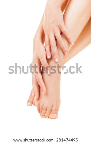 Beautiful and well-groomed female feet isolated on a white background - stock photo