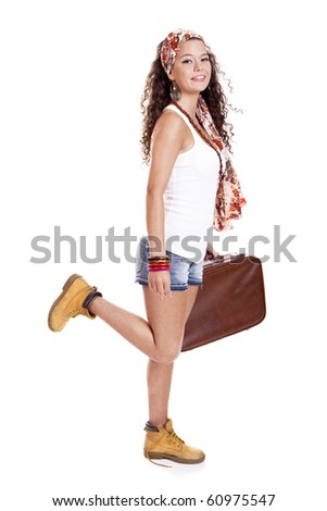 Beautiful and young fashion woman with a old suitcase, isolated on white background