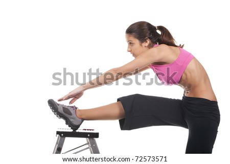 Beautiful and young fitness woman exercising - stock photo