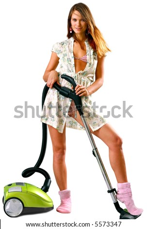 Beautiful and young housewife with green vacuum cleaner over white background - looking at camera - stock photo