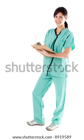 Beautiful and young nurse with a stethoscope and clipboard - stock photo