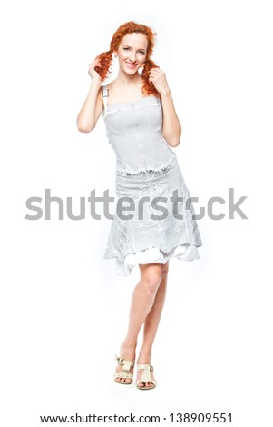beautiful and young woman on an isolated white background