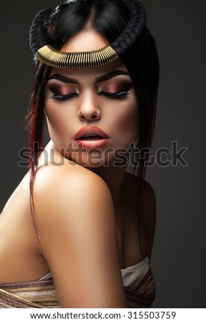 beautiful and young woman with the decoration on the head