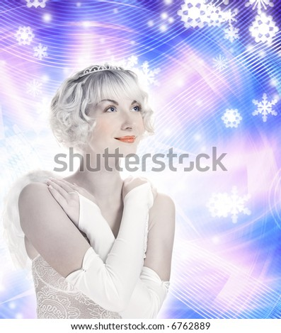 Beautiful Angel girl on abstract winter background