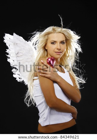 beautiful angel holding a heart