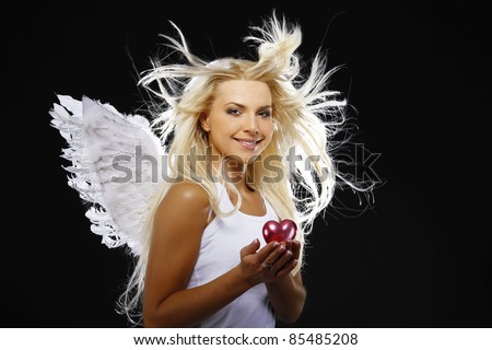 beautiful angel holding a heart - stock photo