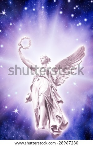 beautiful angel in divine light over blue starry background - stock photo