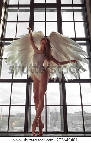 beautiful angel posing in studio - stock photo