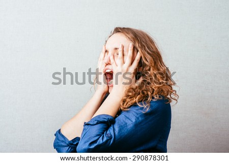 beautiful angry woman in hysterics - stock photo