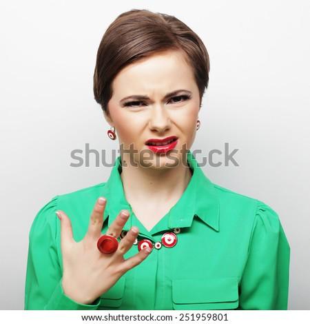 beautiful angry woman, studio shot  - stock photo