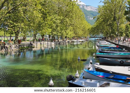 Beautiful Annecy lake and channel with boats