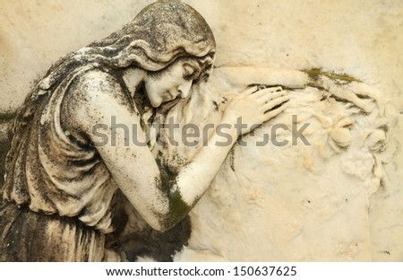 beautiful antique cemetery relief with sleeping angel, Italy, Europe - stock photo