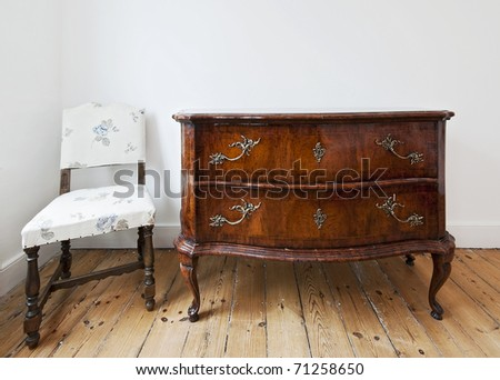 beautiful antique chest of drawers with curly brass handles - stock photo