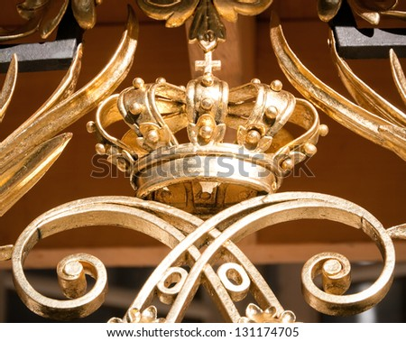 beautiful antique crown at a balcony