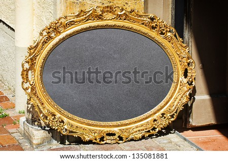 beautiful antique picture frame - nice background - stock photo