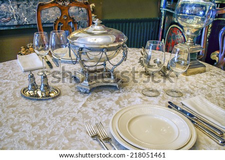 beautiful antique table setting with silver soup bowl - stock photo