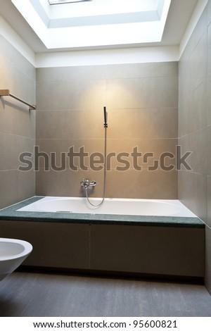 beautiful apartment, interior, bathroom clad in stone - stock photo