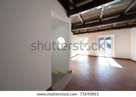 beautiful apartment refitted, exposed beams - stock photo