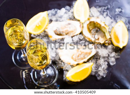 beautiful appetizer oysters and alcohol two glasses wine champagne luxury life background studio food. - stock photo