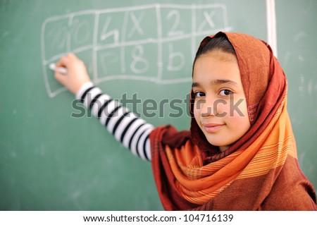 Beautiful arab girl wearing hijab in school - stock photo