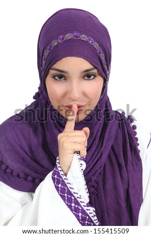 Beautiful arab woman asking for silence with the finger on lips isolated on a white background            - stock photo